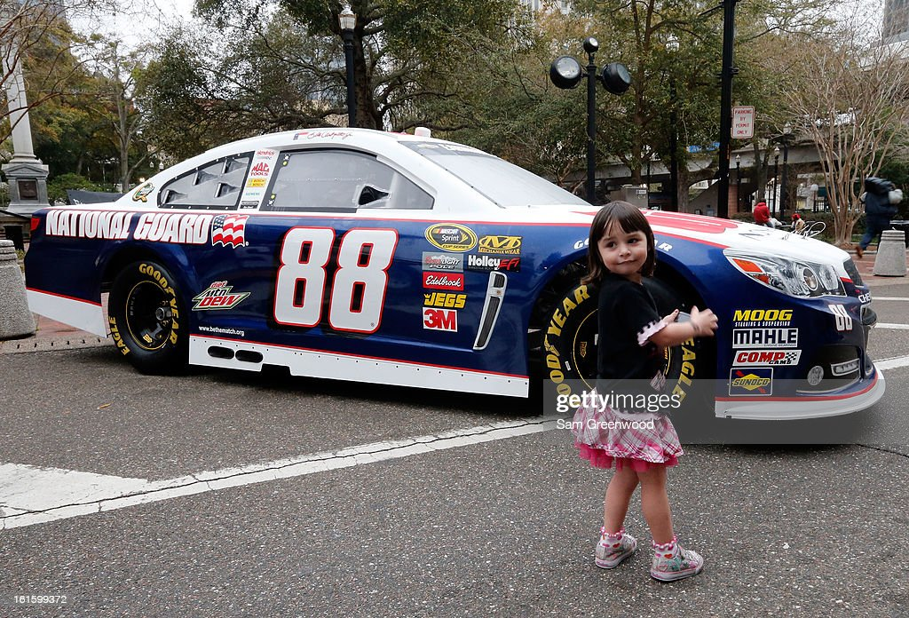 A fan takes a picture of the Gen-6 #88 National Guard/Diet Mountain Dew Chevrolet driven by <a gi-track='captionPersonalityLinkClicked' href=/galleries/search?phrase=Dale+Earnhardt+Jr.&family=editorial&specificpeople=171293 ng-click='$event.stopPropagation()'>Dale Earnhardt Jr.</a> (not pictured) during the Road to Daytona Fueled By Sunoco Tour stop at City Hall on February 12, 2013 in Jacksonville, Florida.
