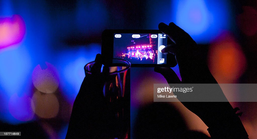 A fan takes a picture on their phone as Deer Tick performs at Brooklyn Bowl on December 5, 2012 in New York City.