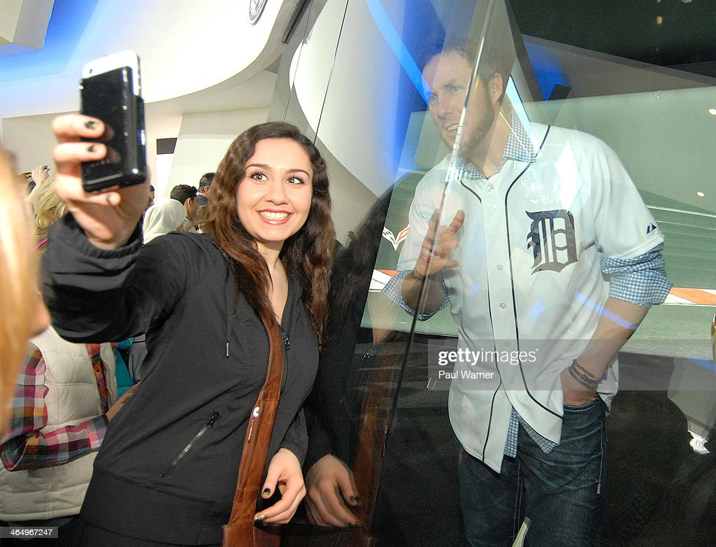 A fan takes a picture with Detroit Tiger <a gi-track='captionPersonalityLinkClicked' href=/galleries/search?phrase=Joe+Nathan&family=editorial&specificpeople=215405 ng-click='$event.stopPropagation()'>Joe Nathan</a> (R) at the Detroit Tigers winter caravan stop at the North American International Auto Show at Cobo Hall on January 24, 2014 in Detroit, Michigan.