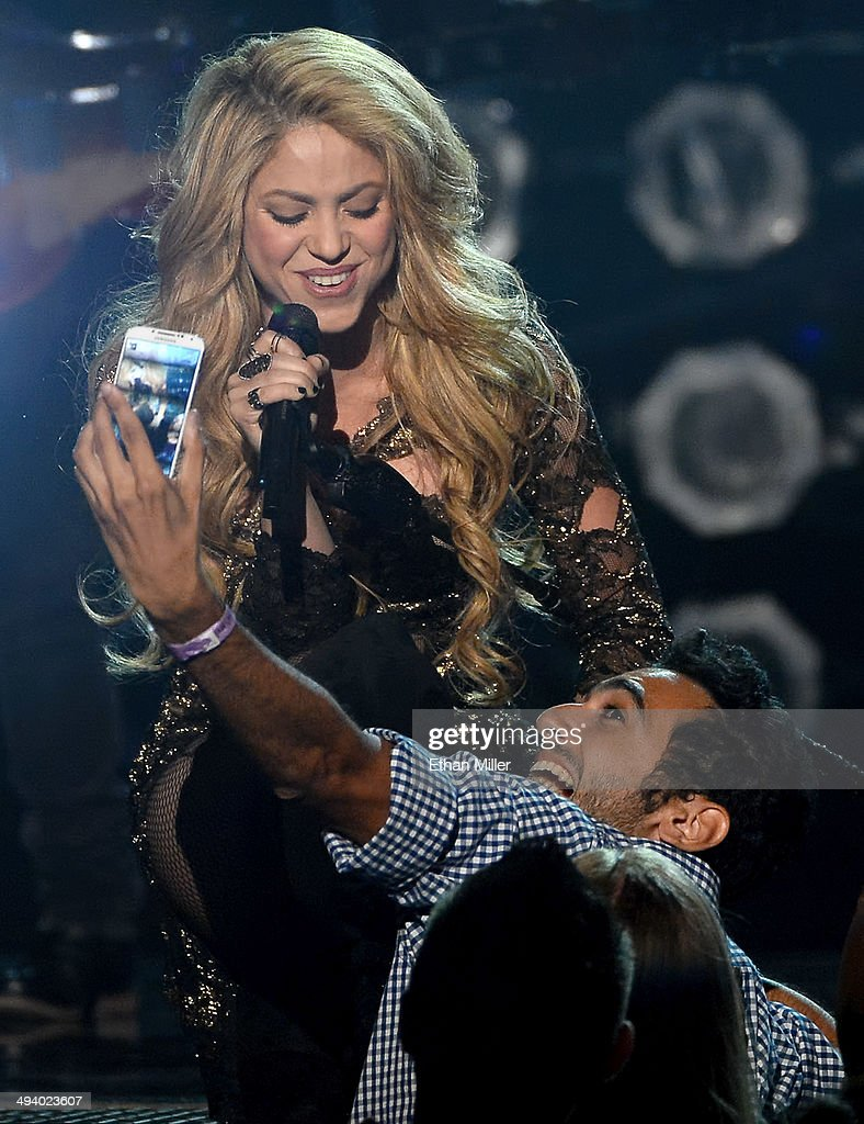 A fan takes a selfie as singer <a gi-track='captionPersonalityLinkClicked' href=/galleries/search?phrase=Shakira&family=editorial&specificpeople=160650 ng-click='$event.stopPropagation()'>Shakira</a> performs during the 2014 Billboard Music Awards at the MGM Grand Garden Arena on May 18, 2014 in Las Vegas, Nevada.