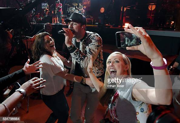 A fan takes a selfie in front of recording artist Sam Hunt as he performs while walking through the crowd during the 2016 iHeartCountry Festival at...
