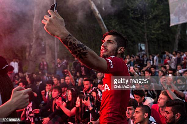 A fan takes a selfie on the street ahead of the opening match of the new Vodafone Arena between Besiktas and Bursaspor on April 11 2016 in Istanbul...
