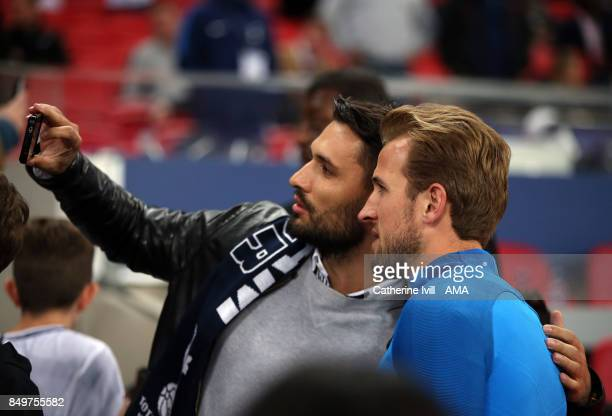A fan takes a selfie photo with Harry Kane of Tottenham Hotspur before the Carabao Cup Third Round match between Tottenham Hotspur and Barnsley at...