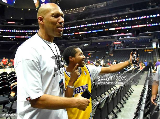 A fan takes a selfie with LaVar Ball at the BIG3 at Staples Center on August 13 2017 in Los Angeles California