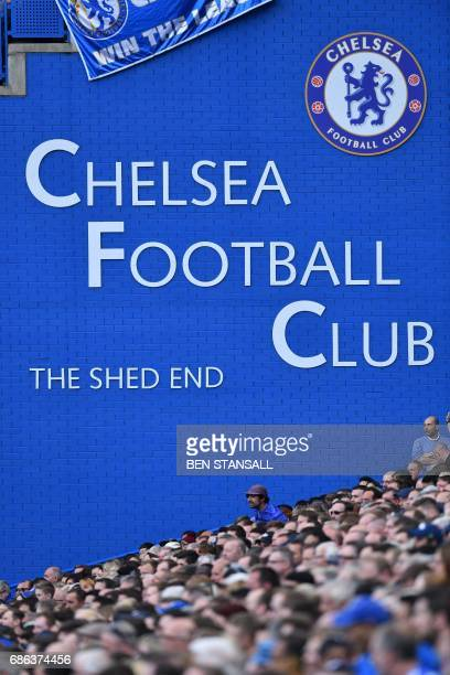A fan takes his seat in the crowd during the English Premier League football match between Chelsea and Sunderland at Stamford Bridge in London on May...