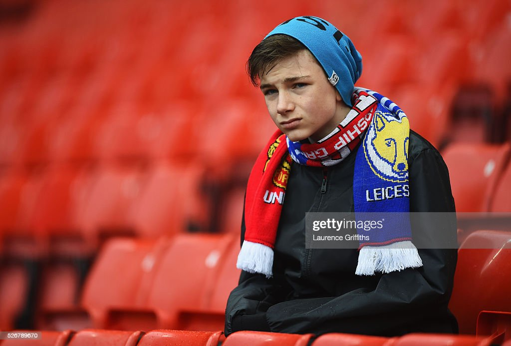 A fan takes his seat prior to the Barclays Premier League match between Manchester United and Leicester City at Old Trafford on May 1, 2016 in Manchester, England.