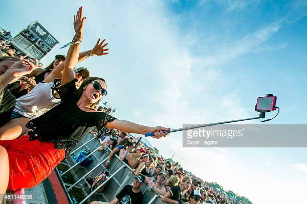 Fan takies selfie with selfie stick on day 1 of the Faster Horses Festival at Michigan International Speedway on July 17 2015 in Brooklyn Michigan