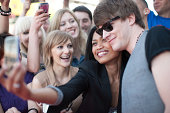 Fan taking picture of herself with celebrity