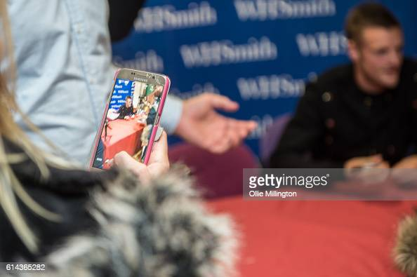 A fan taks a photograph with a camra phone as footballer Jamie Vardy meeting fans and signing copies of his new book 'From Nowhere My Story' on...