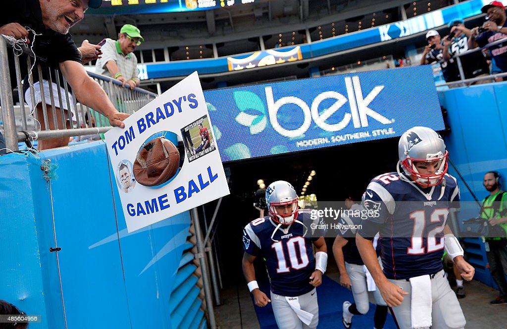 A fan taunts Tom Brady of the New England Patriots as he takes the field during their preseason NFL game against the Carolina Panthers at Bank of...