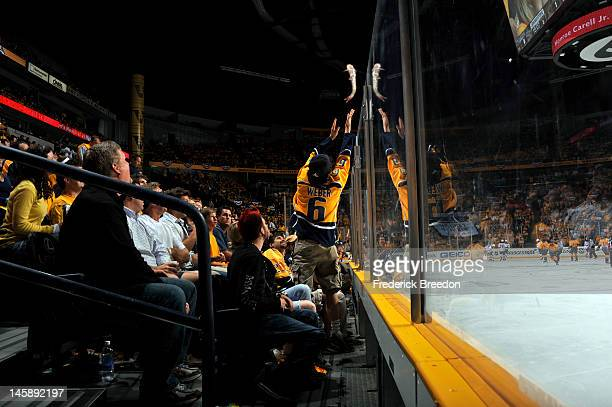A fan throws a catfish onto the ice in Game Four of the Western Conference Semifinals with the Phoenix Coyotes and Nashville Predators during the...