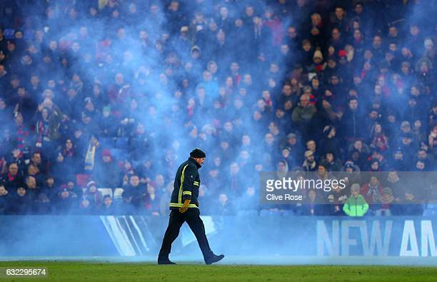 A fan throws a flare on the pitch during the Premier League match between Crystal Palace and Everton at Selhurst Park on January 21 2017 in London...
