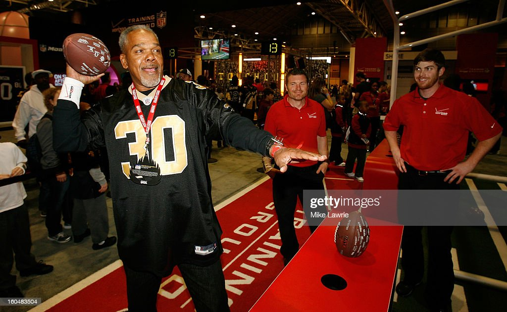 A fan throws a football at a target during the Super Bowl XLVII NFL Experience at the Ernest N. Morial Convention Center on January 31, 2013 in New Orleans, Louisiana.