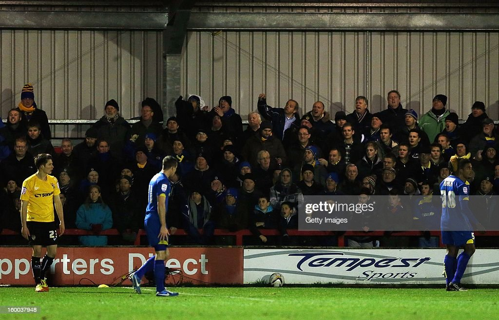 A fan throws an object on to the pitch during the npower League Two match between AFC Wimbledon and Port Vale at The Cherry Red Records Stadium on January 24, 2013 in Kingston upon Thames, England.