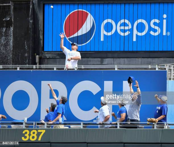 A fan tries to catch the grand slam ball off the bat of Kansas City Royals designated hitter Brandon Moss in the first inning gainst the Chicago...