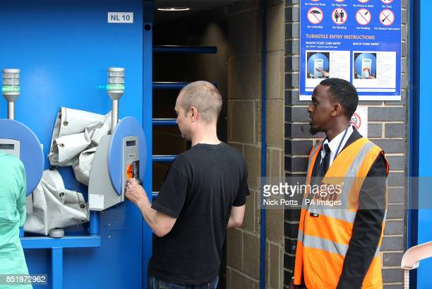 A fan uses the automatic ticket scanning and access system at Stamford Bridge