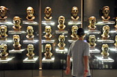 A fan views the busts of former inductees prior to this year's induction ceremony at the Pro Football Hall of Fame on August 6 2011 in Canton Ohio