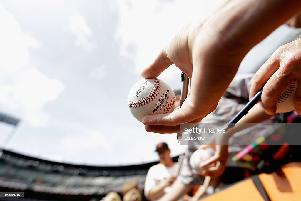 A fan waits for an autograph with a Major League Baseball before the San Francisco Giants game against the St. Louis Cardinals at AT&T Park on April 5, 2013 in San Francisco, California.