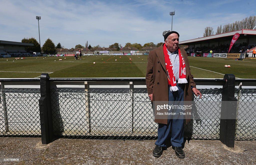 A fan waits for kick off prior to the WSL match between Arsenal Ladies and Birmingham City Ladies at Meadow Park on May 1, 2016 in Borehamwood, England.