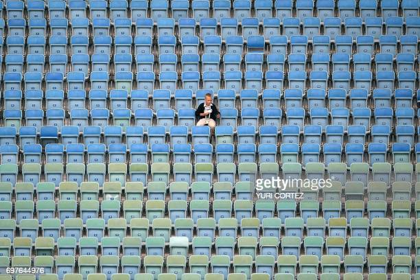 TOPSHOT A fan waits for the start of the 2017 Confederations Cup group B football match between Australia and Germany at the Fisht Stadium in Sochi...