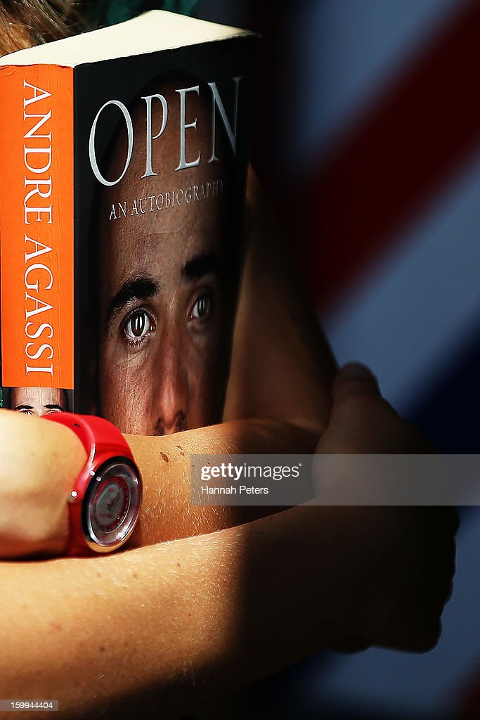 A fan waits in line for Andre Agassi to sign her copy of his autobiography, Open, at Paper Plus Newmarket on January 24, 2013 in Auckland, New Zealand.