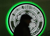 A fan walks past a Celtic logo prior to the UEFA Europa League Group A match between Celtic FC and AFC Ajax at Celtic Park on November 26 2015 in...