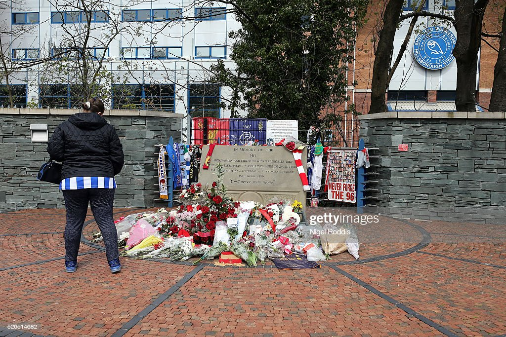 A fan walks past a memorial to the Liverpool fans who died at Hillsborough in 1989 ahead of the Sky Bet Championship match between Sheffield Wednesday and Cardiff City at Hillsborough stadium on April 30, 2016 in Sheffield, England.