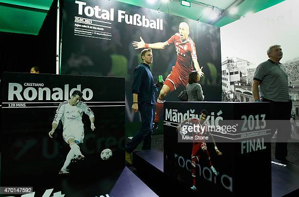 A fan walks past an exhibit at the 2015 UEFA Champions League Trophy Tour presented by Heineken VIP Reception on April 17 2015 in Dallas Texas