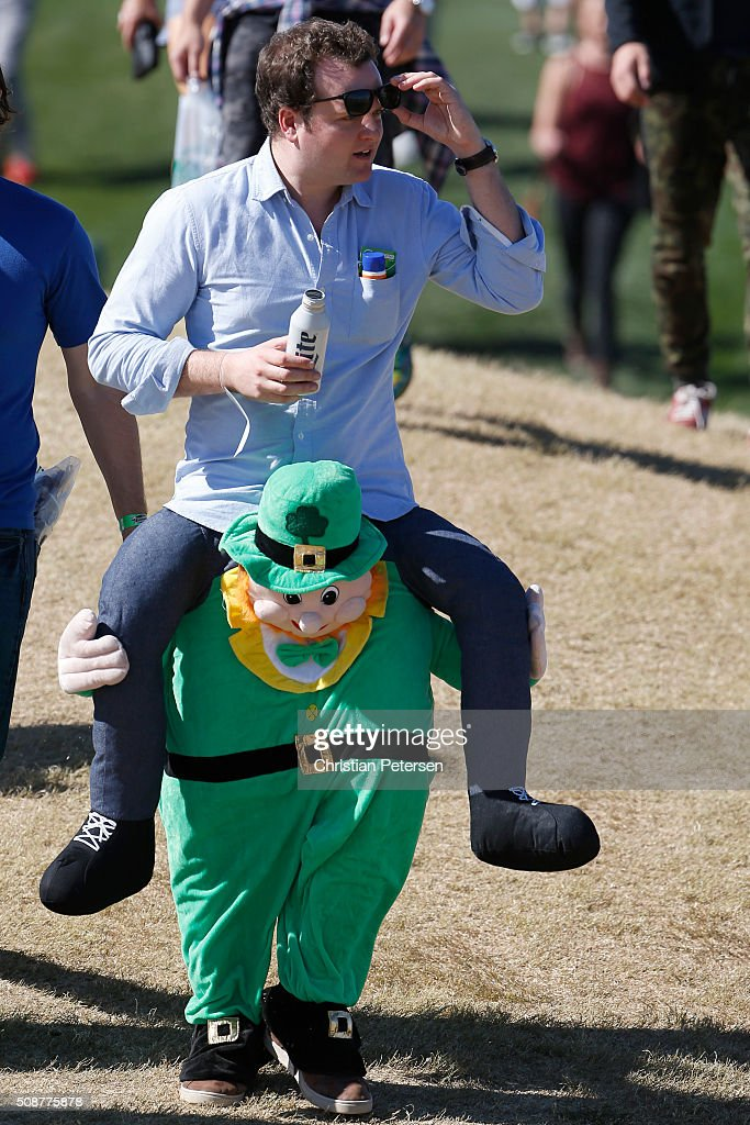 A fan walks through the crowd during the third round of the Waste Management Phoenix Open at TPC Scottsdale on February 6, 2016 in Scottsdale, Arizona.