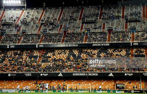 Fan watch play during the Spanish Copa del Rey football match Valencia CF vs FC Barcelona at Mestalla stadium in Valencia on February 10 2016 / AFP /...