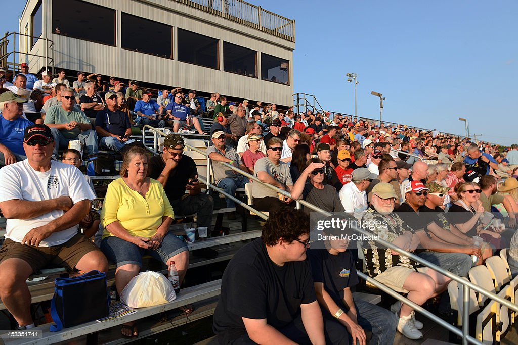 Fan watch the early races prior to the Call Before You Dig 811 150 at Stafford Motor Speedway August 8, 2014 in Stafford, Connecticutt.