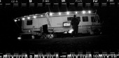 A fan watches a football game in front of his RV in the infield after the NASCAR Camping World Truck Series CocaCola 250 powered by Fred's at...