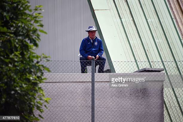 A fan watches from a rooftop during the first training session of SV Darmstadt 98 at HEAGStadion on June 20 2015 in Darmstadt Germany
