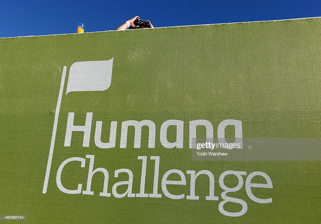 A fan watches players on the 18th hole during round three of the Humana Challenge in Partnership with The Clinton Foundationon on the Arnold Palmer...