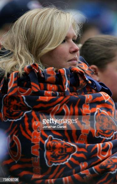 A fan watches the Chicago White Sox paly the Cleveland Indians wrapped in a Chicago Bears blanket on April 4 2007 at US Cellular Field in Chicago...