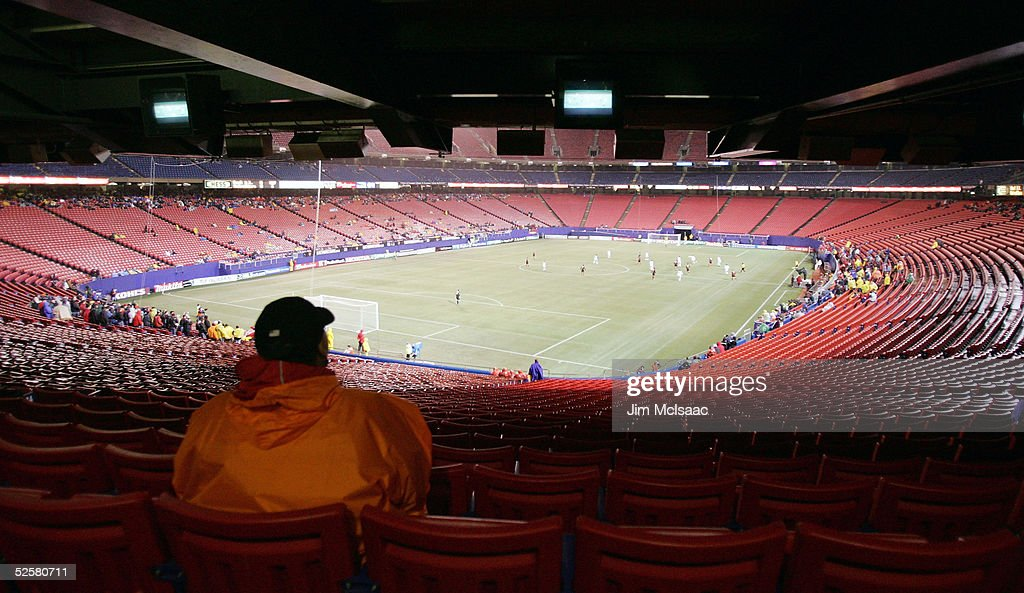 A fan watches the game between the MetroStars and Real Salt Lake from under an overhang as their Major League Soccer match is played in very high...
