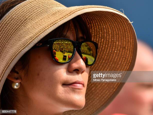 A fan watches the match between Roger Federer of Switzerland and Roberto Bautista Agut of Spain during day eight of the Rogers Cup presented by...