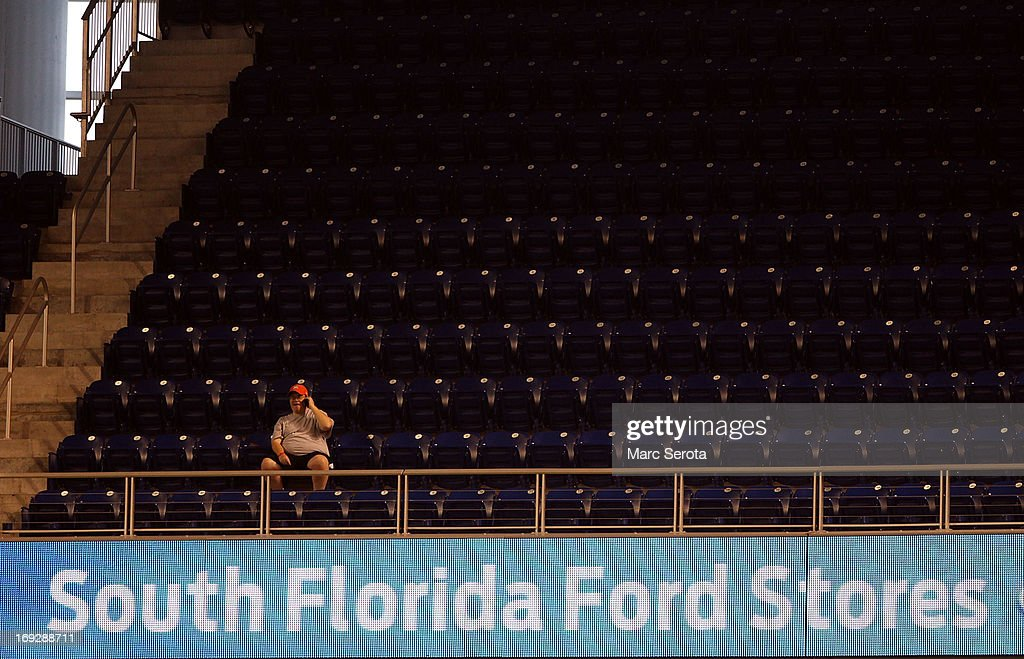 A fan watches the Philadelphia Phillies play against the Miami Marlins at Marlins Park on May 22, 2013 in Miami, Florida.