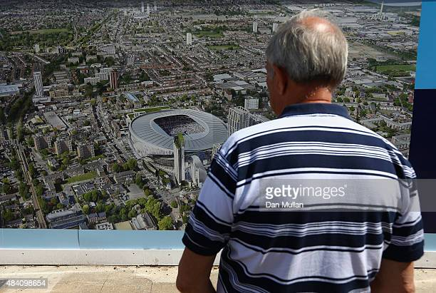A fan watches the picture of the new stadium plan prior to the Barclays Premier League match between Tottenham Hotspur and Stoke City at White Hart...
