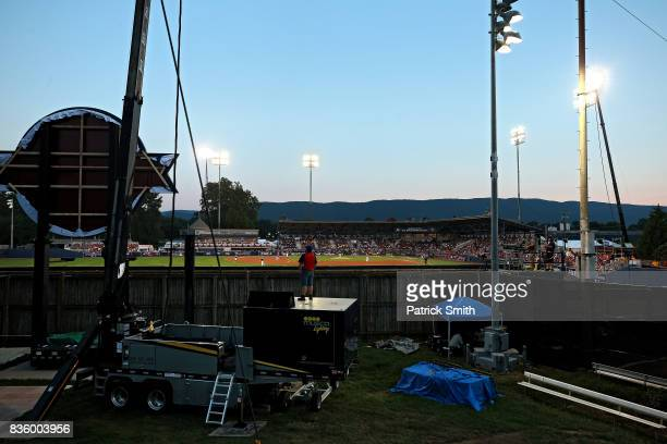 A fan watches the Pittsburgh Pirates play the St Louis Cardinals in the inaugural MLB Little League Classic at BBT Ballpark at Historic Bowman Field...