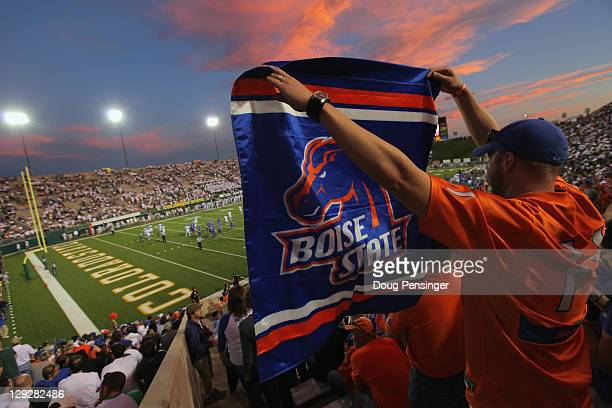 A fan waves a flag in support of the Boise State Broncos as they face the Colorado State Rams at Sonny Lubick Field at Hughes Stadium on October 15...