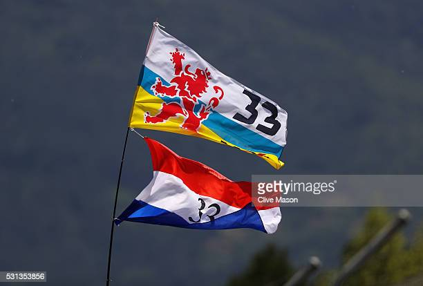 A fan waves a flag to support Max Verstappen of Netherlands and Red Bull Racing during qualifying for the Spanish Formula One Grand Prix at Circuit...