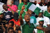 A fan waves a flag to support the Nigerian team during the 2013 African Cup of Nations second leg qualifying matchat Calabar October 13 2012 Nigeria...