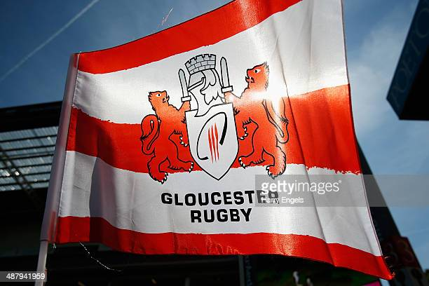 A fan waves a Gloucester Rugby flag ahead of kick off during the Aviva Premiership match between Gloucester and London Irish at Kingsholm Stadium on...