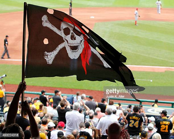 A fan waves a Jolly Roger flag during the game against the Cincinnati Reds at PNC Park on June 19 2014 in Pittsburgh Pennsylvania
