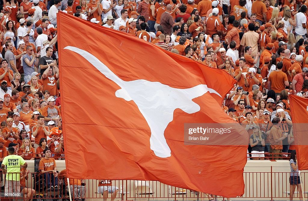 A fan waves a large Lonhorns flag during the game between the Louisiana Monroe Warhawks and the Texas Longhorns on September 5 2009 at Darrell K...