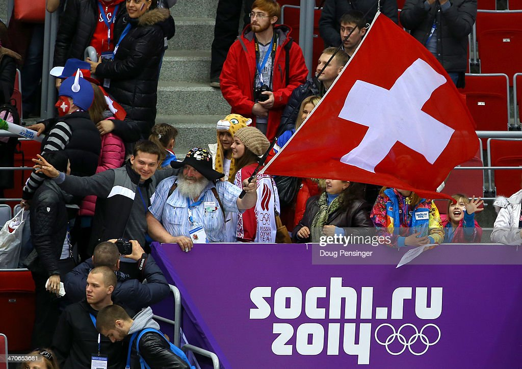 A fan waves a swiss flag after Switzerland defeated Sweden 4-3 during the Ice Hockey Women's Bronze Medal Game on day 13 of the Sochi 2014 Winter Olympics at Bolshoy Ice Dome on February 20, 2014 in Sochi, Russia.