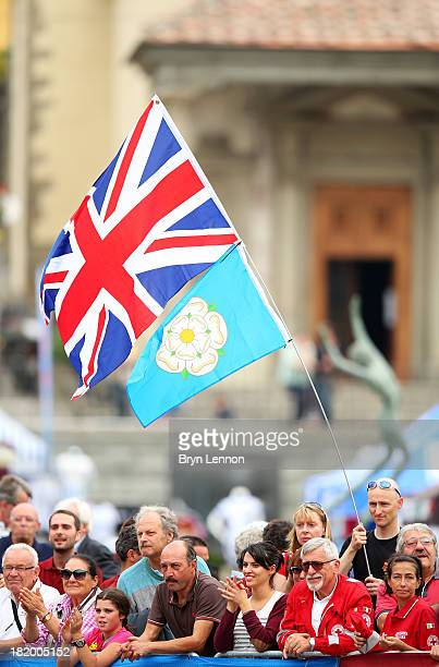 A fan waves a Union jack flag and a Yorkshire rose flag during the Under 23 Men's Road Race on September 27 2013 in Florence Italy
