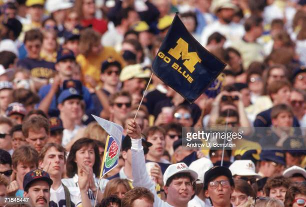 A fan waves a University of Michigan Wolverines flag during the Rose Bowl against Arizona State University Sun Devils on January 1 at the Rose Bowl...