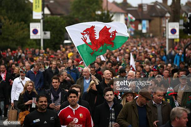 A fan waves a Welsh flag as fans make their way to Twickenham Stadium on October 17 2015 in Twickenham London England Fans are gearing up ahead of...